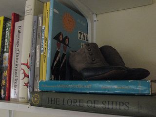 oldy timey shoes and books